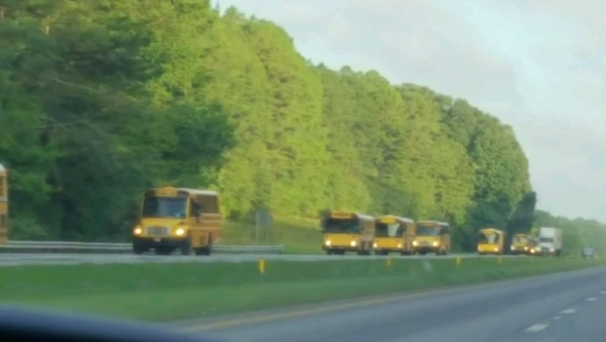 Convoys of school buses headed east for the evacuation on I-26 on Wednesday. (Photo credit: Mike and Dawn Liedtke)