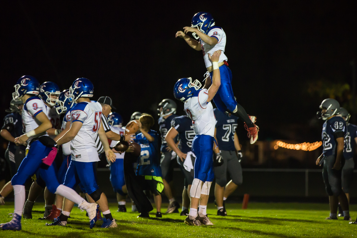 Churchill running back Dalton McDaniel (#8) is hoisted in the air in celebration of his touchdown. The Churchill Lancers defeated the Springfield Millers 56-7 in a cold game Friday night. Friday night's win extended Churchill's season to 7-0. Photo by Dillon Vibes