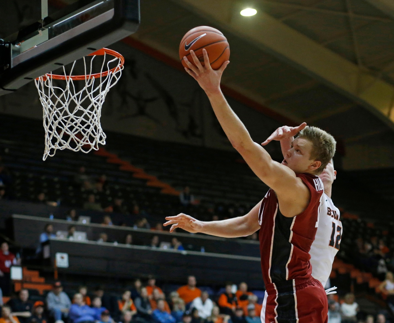 Stanford's Michael Humphrey drives to the basket past Oregon State's Drew Eubanks (12) during the second half of an NCAA college basketball game in Corvallis, Ore., Thursday, Jan. 19, 2017. Stanford won 62-46. (AP Photo/Timothy J. Gonzalez)