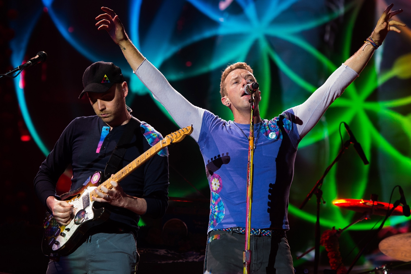 Chris Martin, right, and Jonny Buckland from the band Coldplay perform at MetLife Stadium on Saturday, July 16, 2016, in East Rutherford, New Jersey. (Photo by Charles Sykes/Invision/AP)