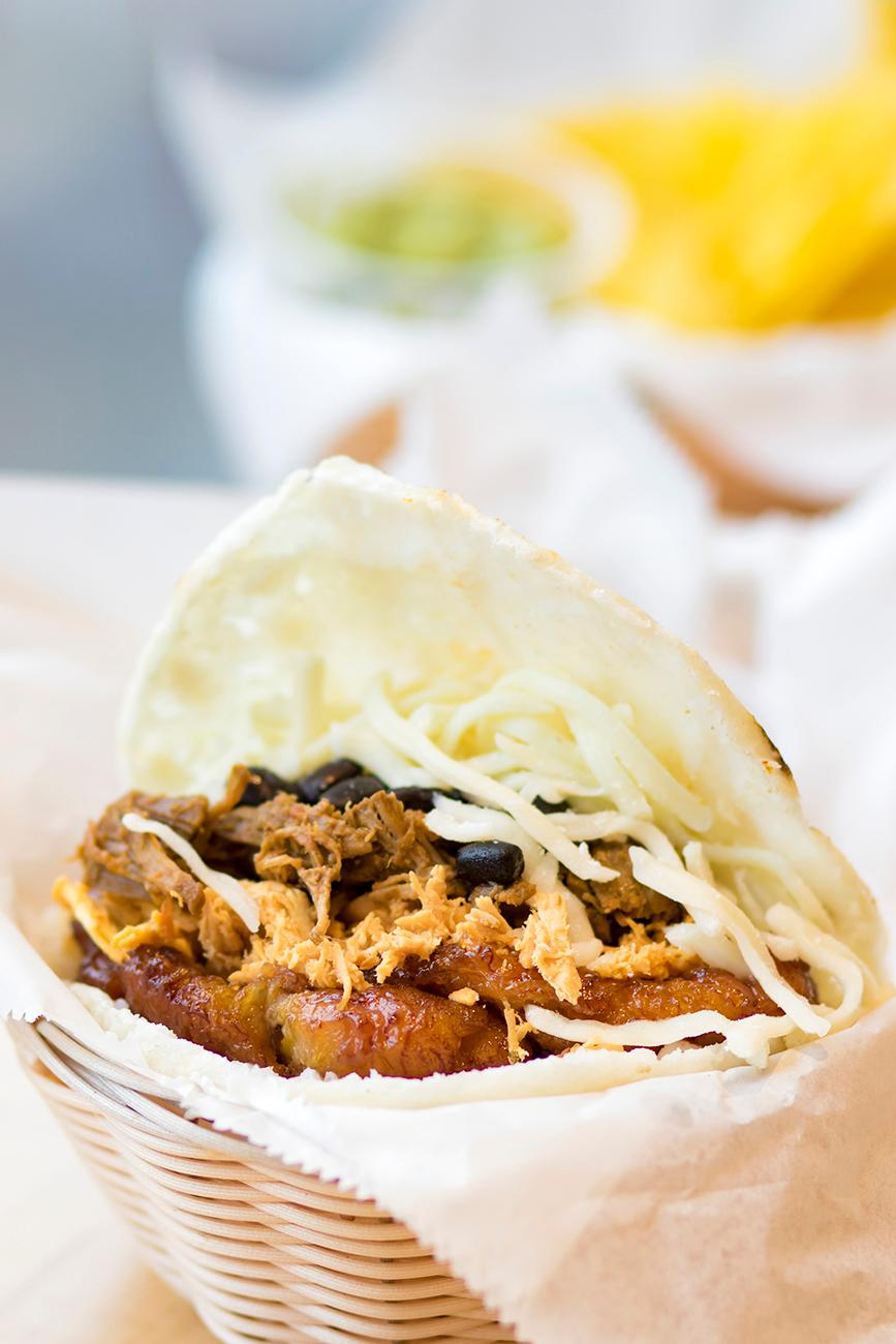 The Great Arepa!: beef, chicken, chorizo, black beans, cheese, and sweet plantains{ }/ Image: Allison McAdams // Published: 3.4.19