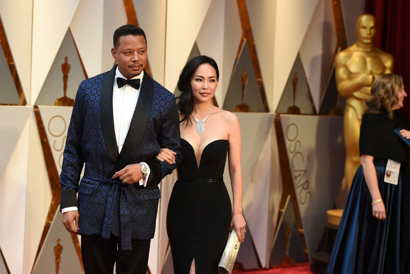 Terrence Howard, left, and Miranda Pak arrive at the Oscars on Sunday, Feb. 26, 2017, at the Dolby Theatre in Los Angeles. (Photo by Jordan Strauss/Invision/AP)