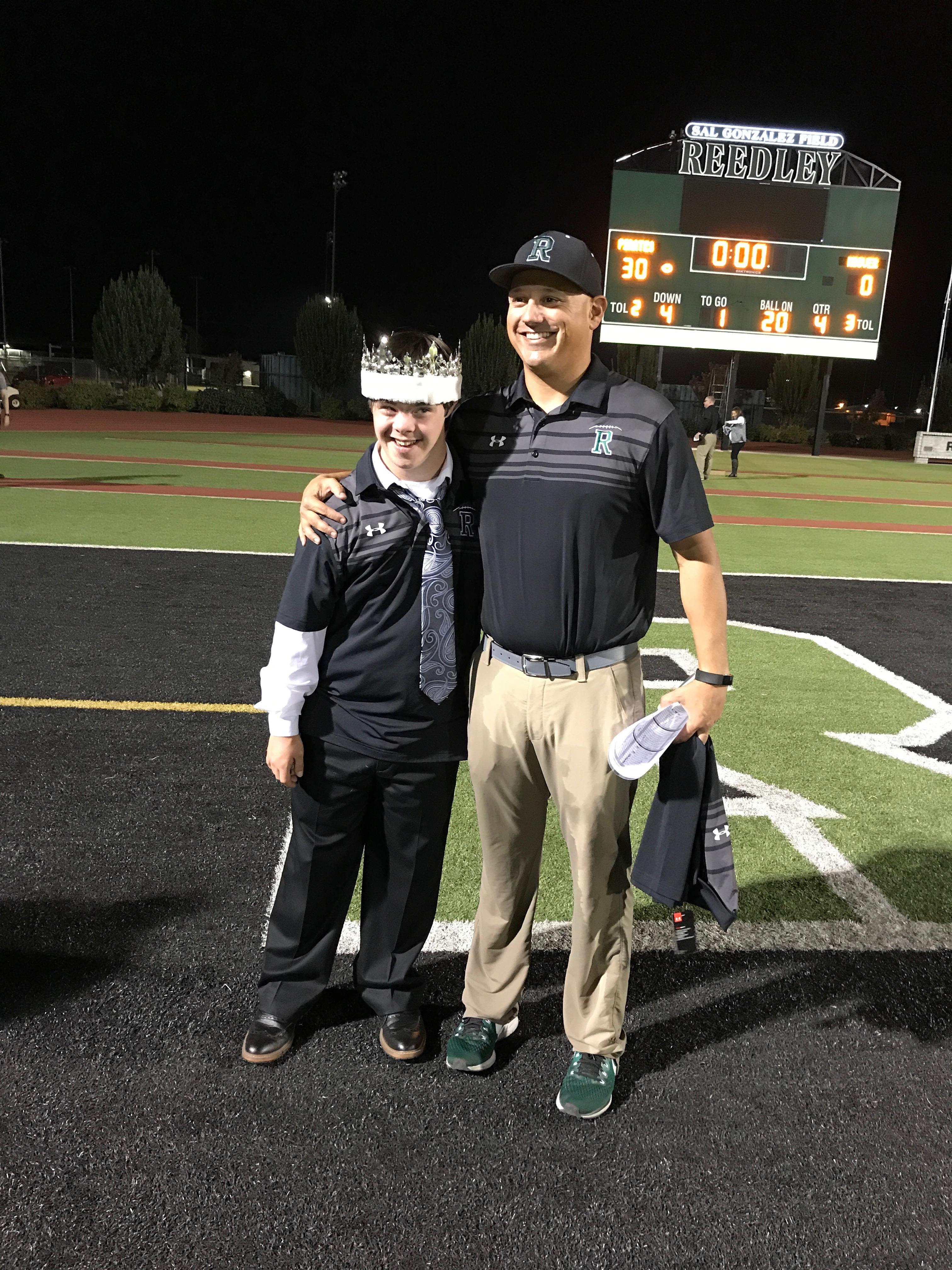 Jack Welsh with Reedley football coach Brandon Nagle, after being named Homecoming King.