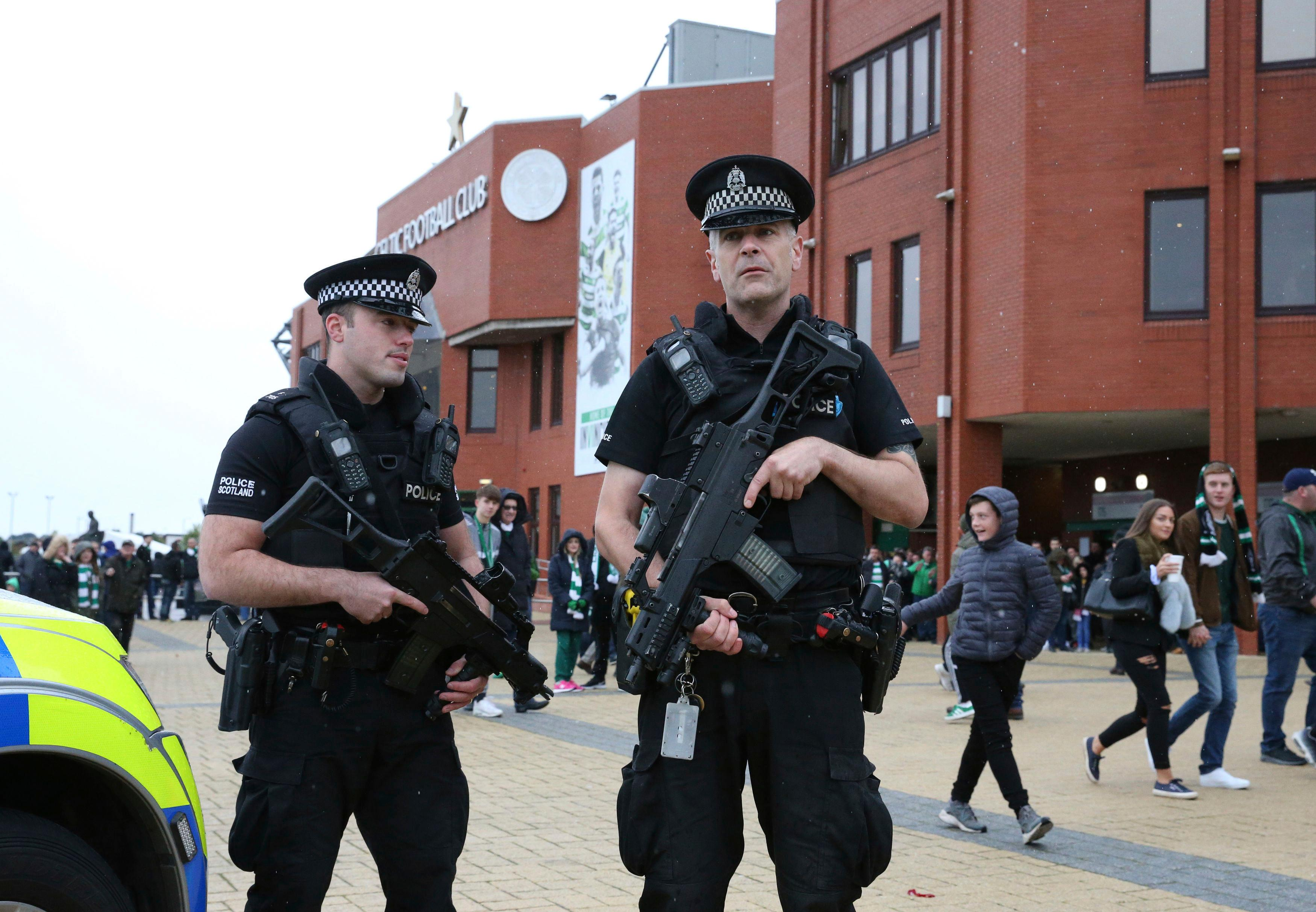 "Armed police outside Celtic Park prior to the Scottish Premiership soccer match at Celtic Park in Glasgow, Scotland, Saturday Sept. 16, 2017.  There are hundreds of troops and armed police deployed at public sites throughout Britain Saturday to beef up security, as British officials left the terrorist threat warning level at ""critical,"" following Friday's subway blast in London. (Andrew Milligan/PA via AP)"