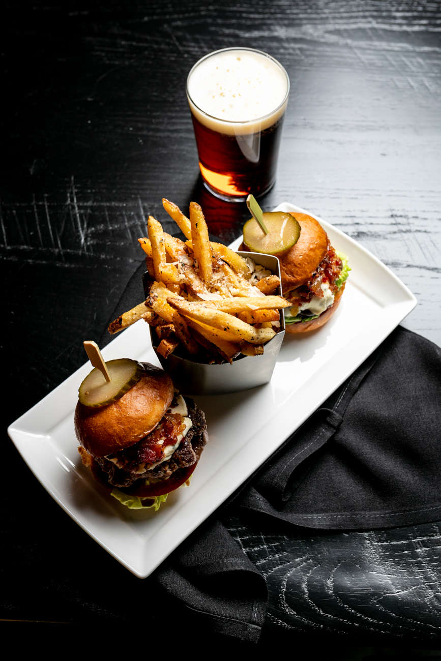 Angus sliders topped with bacon jam, Boursin cheese, tomato, and bibb lettuce on a 16 Bricks bun served with truffle fries / Image: Amy Elisabeth Spasoff // Published: 11.28.18