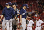 Milwaukee Brewers starting pitcher Zach Davies, center, leaves the baseball game after giving up an RBI single to Cincinnati Reds' Eugenio Suarez during the sixth inning Tuesday, Sept. 5, 2017, in Cincinnati.