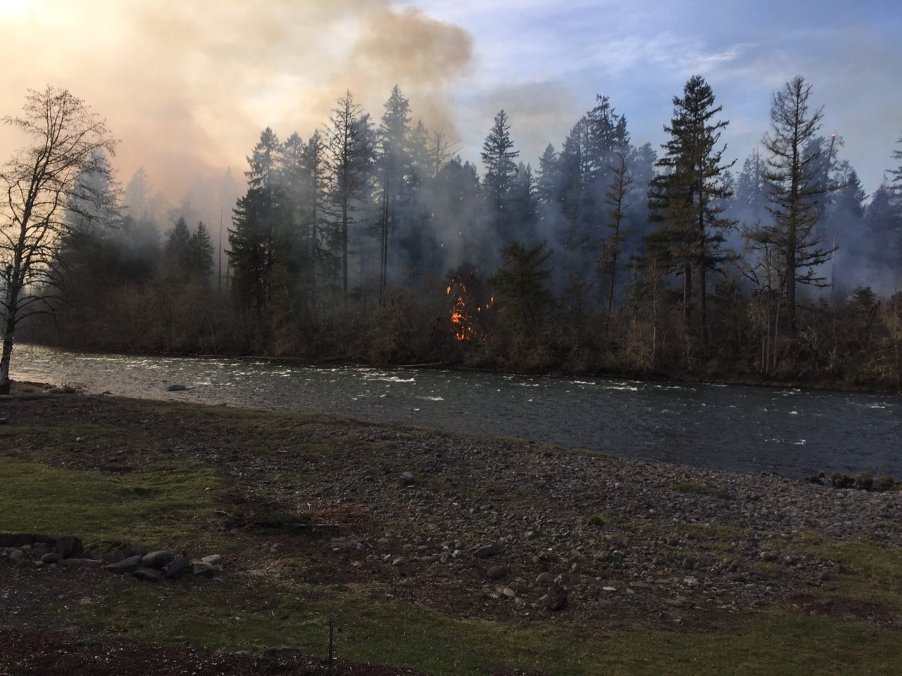 Fire burns along the bank of the Santiam River in the North Santiam State Recreational Area Tuesday, March 19, 2019. Photo courtesy Berva Bennett{ }