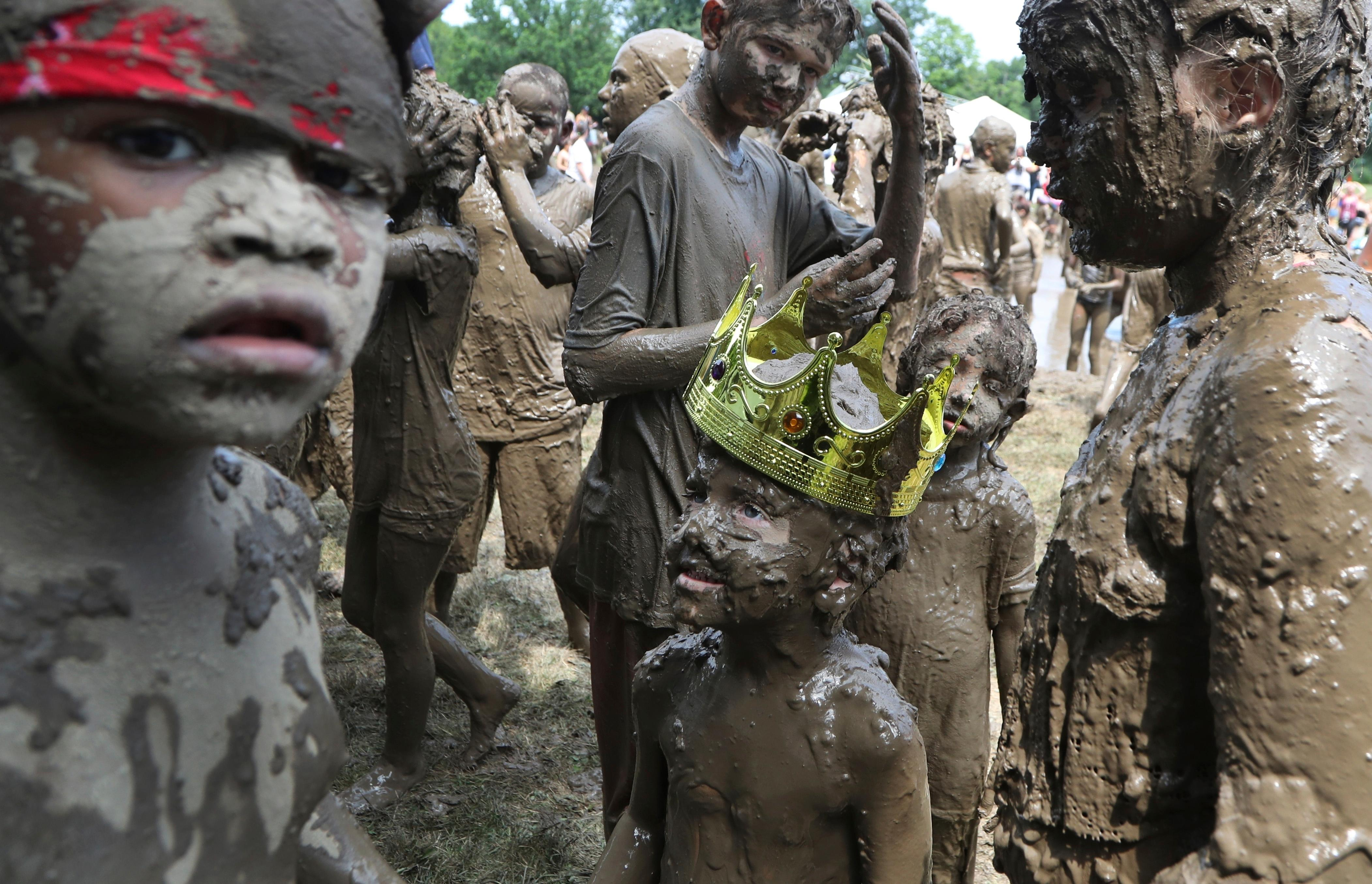 Charles Daviskiba, 3, is seen after being crowned Mud Day King during Mud Day at the Nankin Mills Park, Tuesday, July 10, 2018, in Westland, Mich. The event marked the 31st year Wayne County Parks has hosted the event. While much of the event was children and parents playing in the mud, park officials organized various races and a limbo line. (AP Photo/Carlos Osorio)