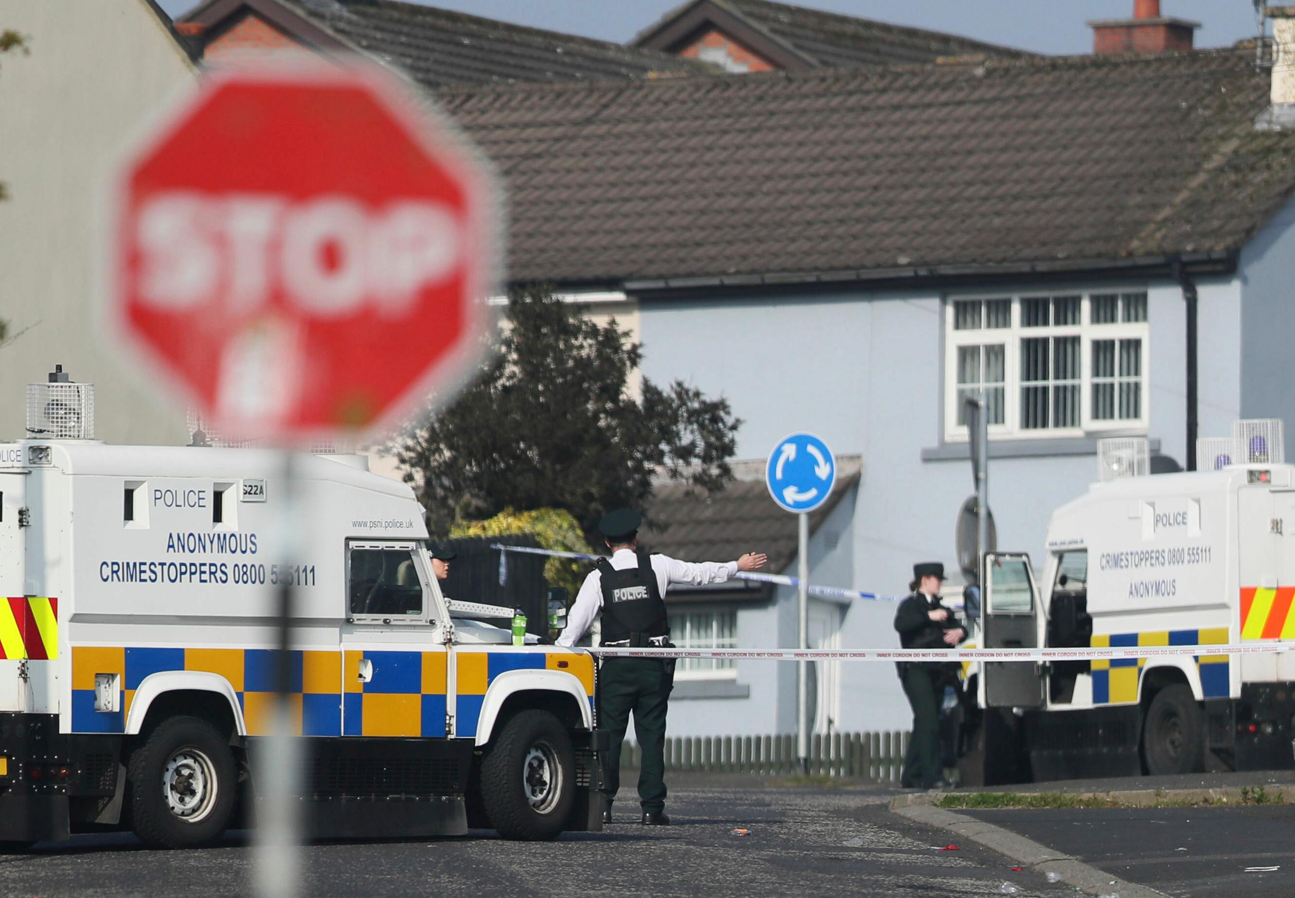 The scene in Londonderry, Northern Ireland, Friday April 19, 2019, following the death of 29-year-old journalist Lyra McKee who was shot and killed during overnight rioting.  Police in Northern Ireland said Friday the dissident republican group the New IRA was probably responsible for the fatal shooting of a journalist during overnight rioting in the city of Londonderry. (Brian Lawless/PA via AP)