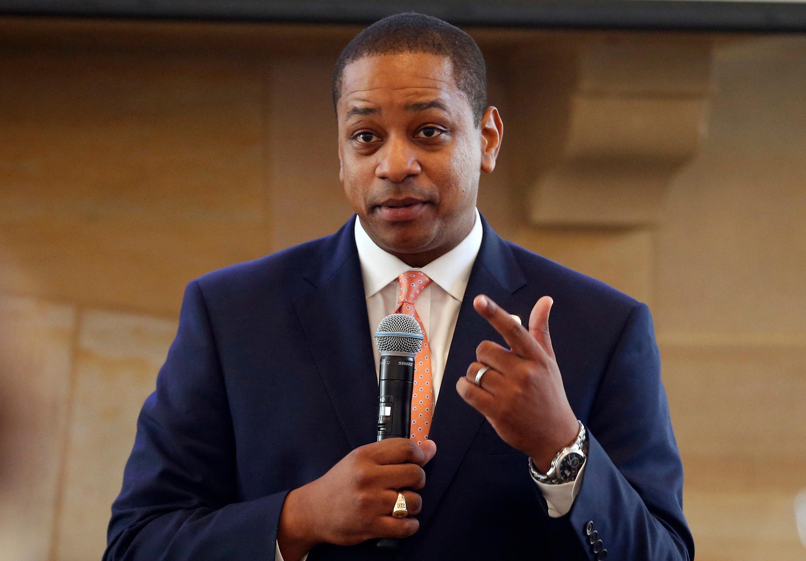 FILE- In this Sept. 25, 2018, file photo, Virginia Lt. Gov. Justin Fairfax gestures during remarks before a meeting of the Campaign to reduce evictions at a church meeting room in Richmond, Va. (AP Photo/Steve Helber)