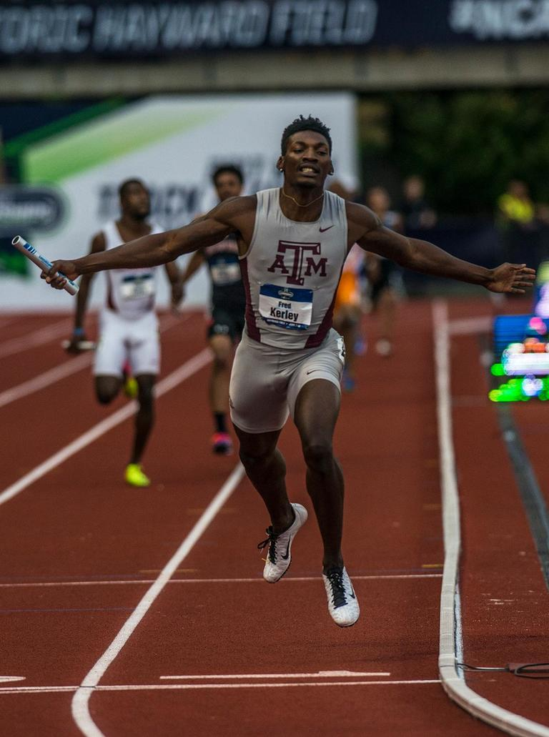Fred Kerley, the anchor on the Texas A&M 4x400m relay team crosses the finish line first with a time of 2:59.95 on day one of the NCAA Division I Championships at Hayward Field. Photo by Rhianna Gelhart, Oregon News Lab