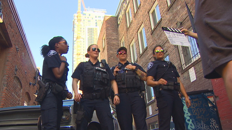 <p>Police officers swarmed Seattle's Belltown neighborhood Tuesday, July 17, 2018, but it wasn't for an investigation - is was a parade. The Seattle Police Department took over the streets to film a lip sync video in the hopes of becoming the internet's next viral sensation. (Photo: KOMO News)</p>