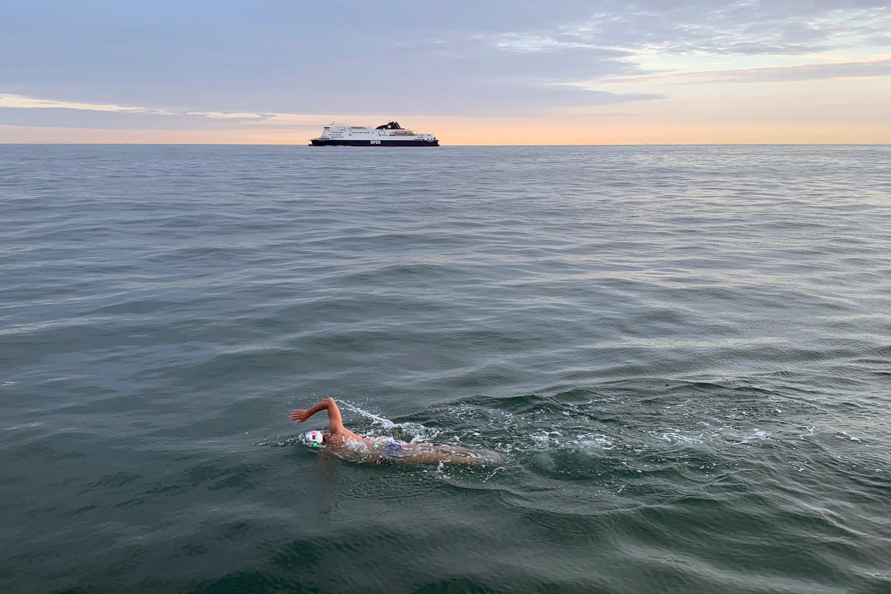 This July 9, 2019, photo provided by Caroline Gleich shows Rob Lea swimming the English Channel, from England to France. Lea climbed Mount Everest, swam across the English Channel and biked from one American coast to the other in a six-month span. (Caroline Gleich via AP)