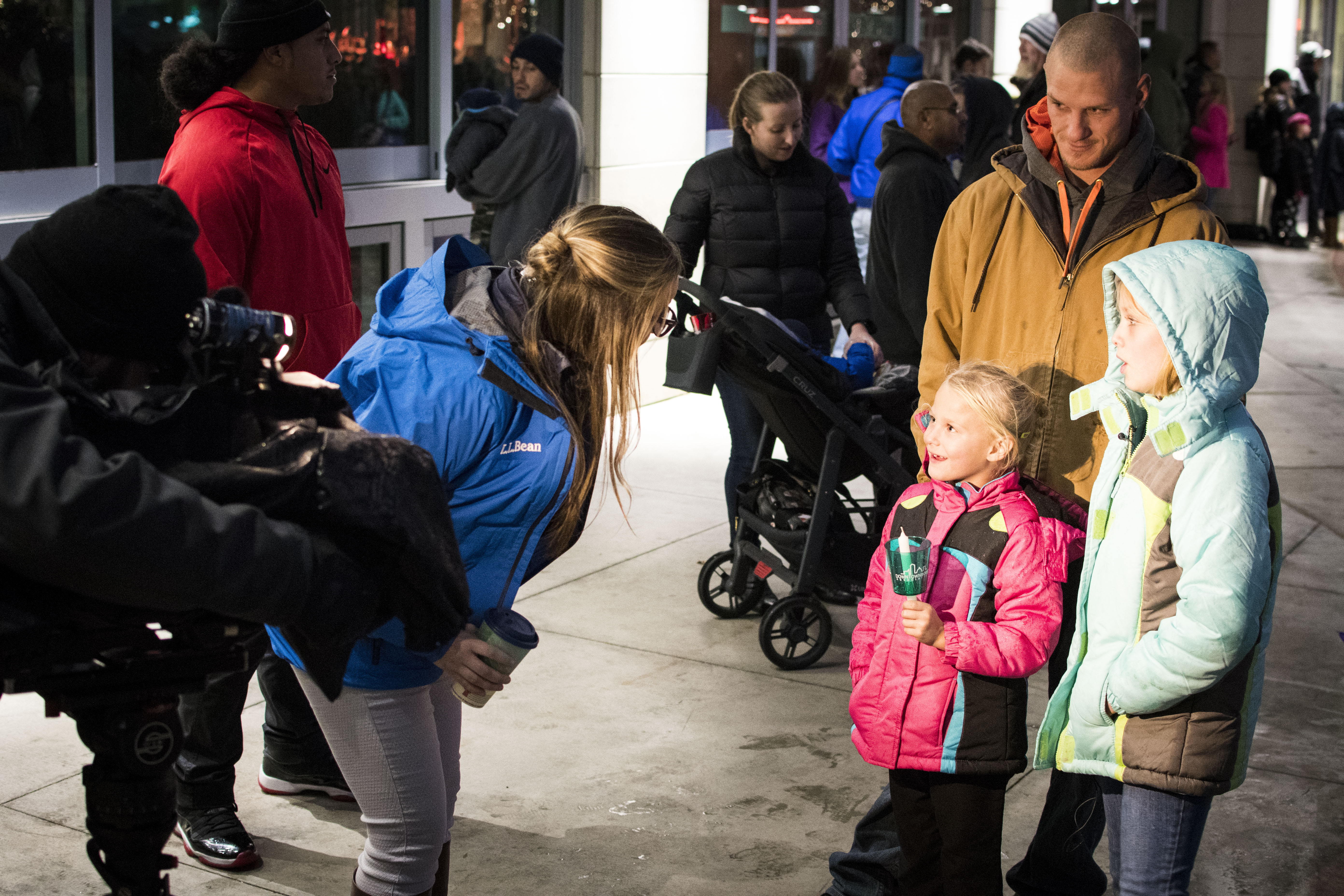 Hundreds of lights danced in the Grove Plaza as the Downtown Boise Tree Lighting took place Friday. People held candles and gathered despite the rain, to watch Mayor Bieter flip the switch to light the giant Christmas tree. (Axel Quartarone Photo)