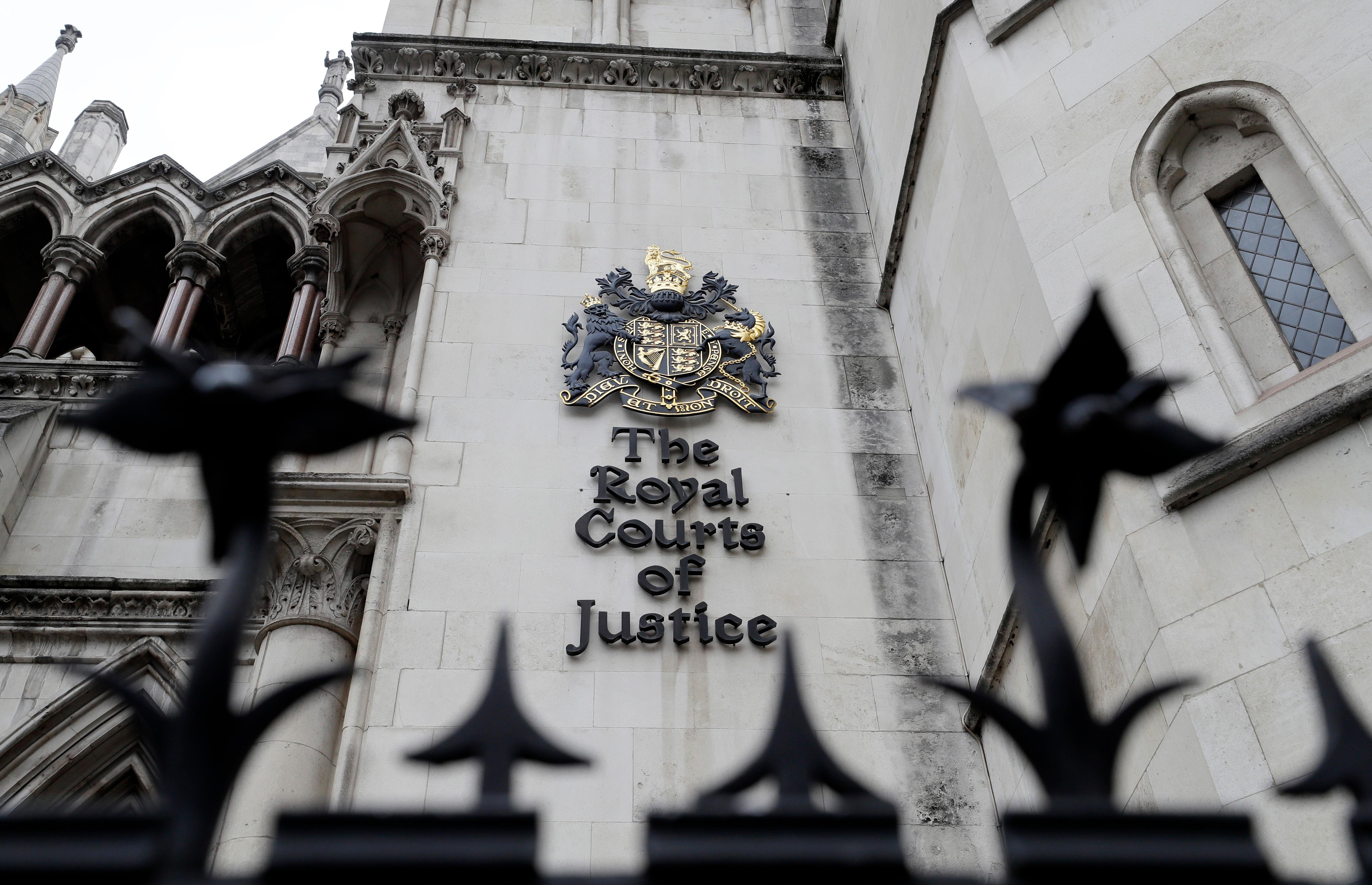 A view of The Royal Courts of Justice also known as The High Court in London, Tuesday, July 30, 2019. Sheikh Mohammed bin Rashid al-Maktoum has made an application to divorce his wife of 15 years, Princess Haya Bint al-Hussein, in the Family Court Division of the High Court. (AP Photo/Kirsty Wigglesworth)