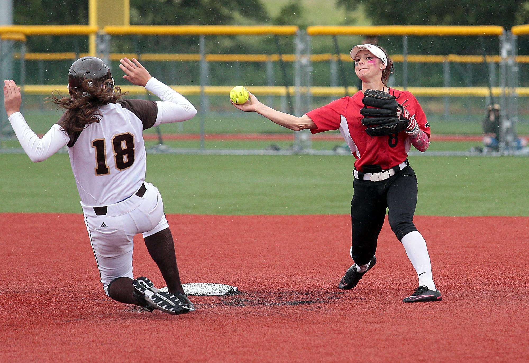 Larry Stauth Jr / for the Mail Tribune Southern Oregon University senior shortstop Kelsey Randall attempts to turn a double play over sliding base runner Hannah Santay of St. Francis on Wednesday at U.S. Cellular Community Park.