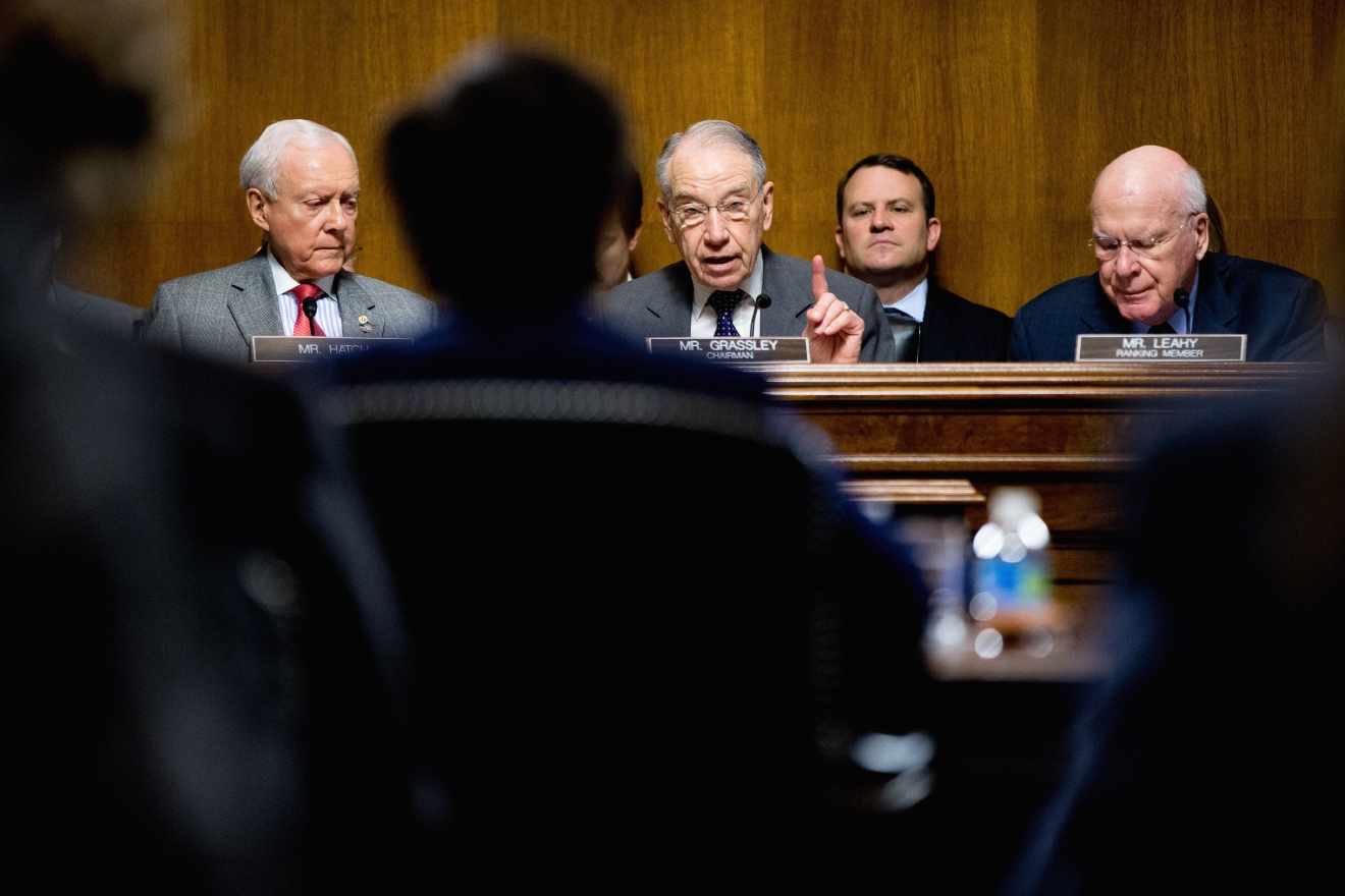 Senate Judiciary Committee Chairman Sen. Charles Grassley, R-Iowa, center, flanked by the committee's ranking member Sen. Patrick Leahy, D-Vt., right, and Sen. Orrin Hatch, R-Utah, questions Attorney General Loretta Lynch, foreground, on Capitol Hill in Washington, Wednesday, March 9, 2016, during the committee's hearing on oversight of the Justice Department.   (AP Photo/Andrew Harnik)