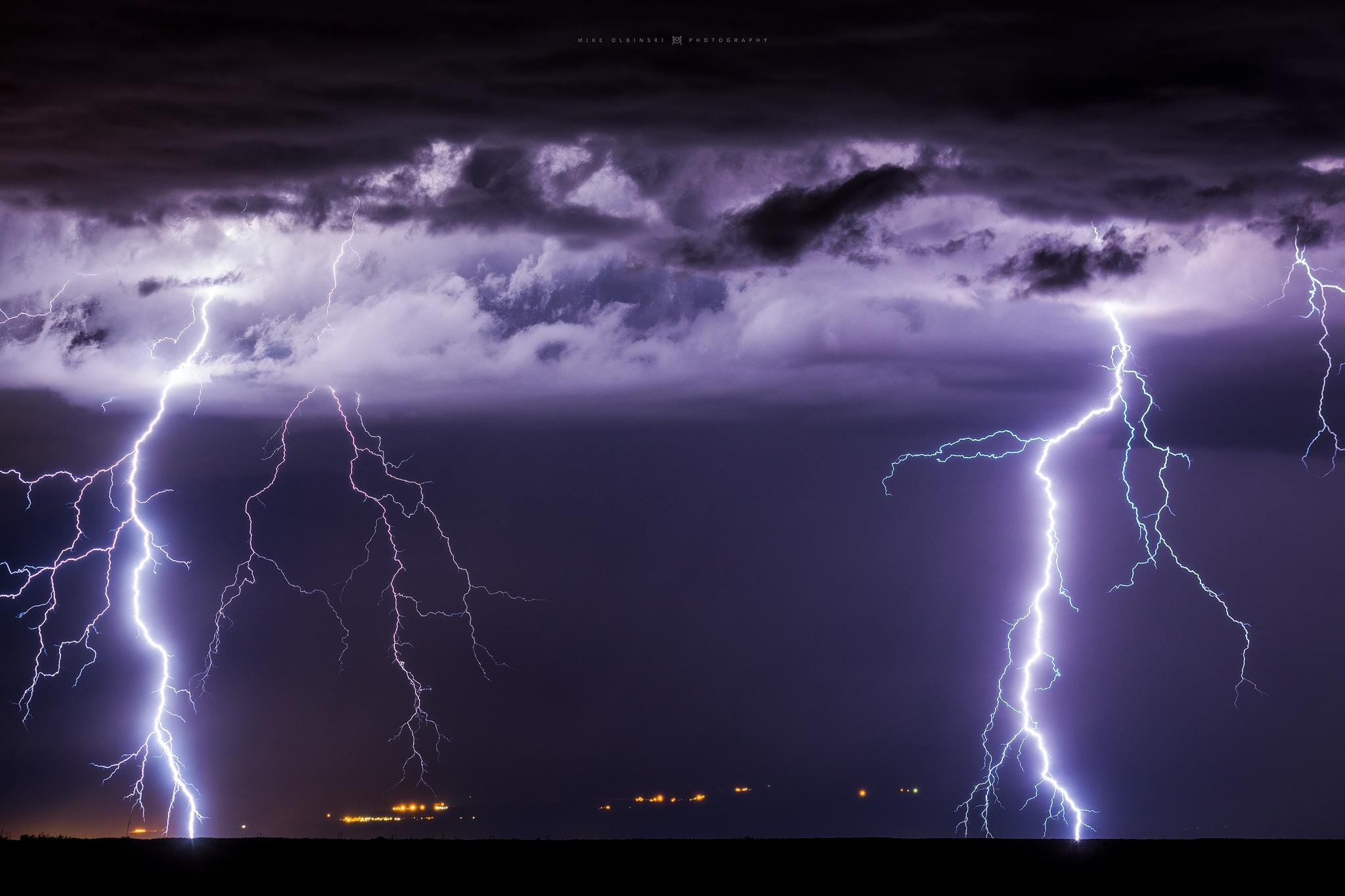 Two powerful bolts slam well away from the storm on the south side of the Safford area{ } (Photo: Mike Olbinski)