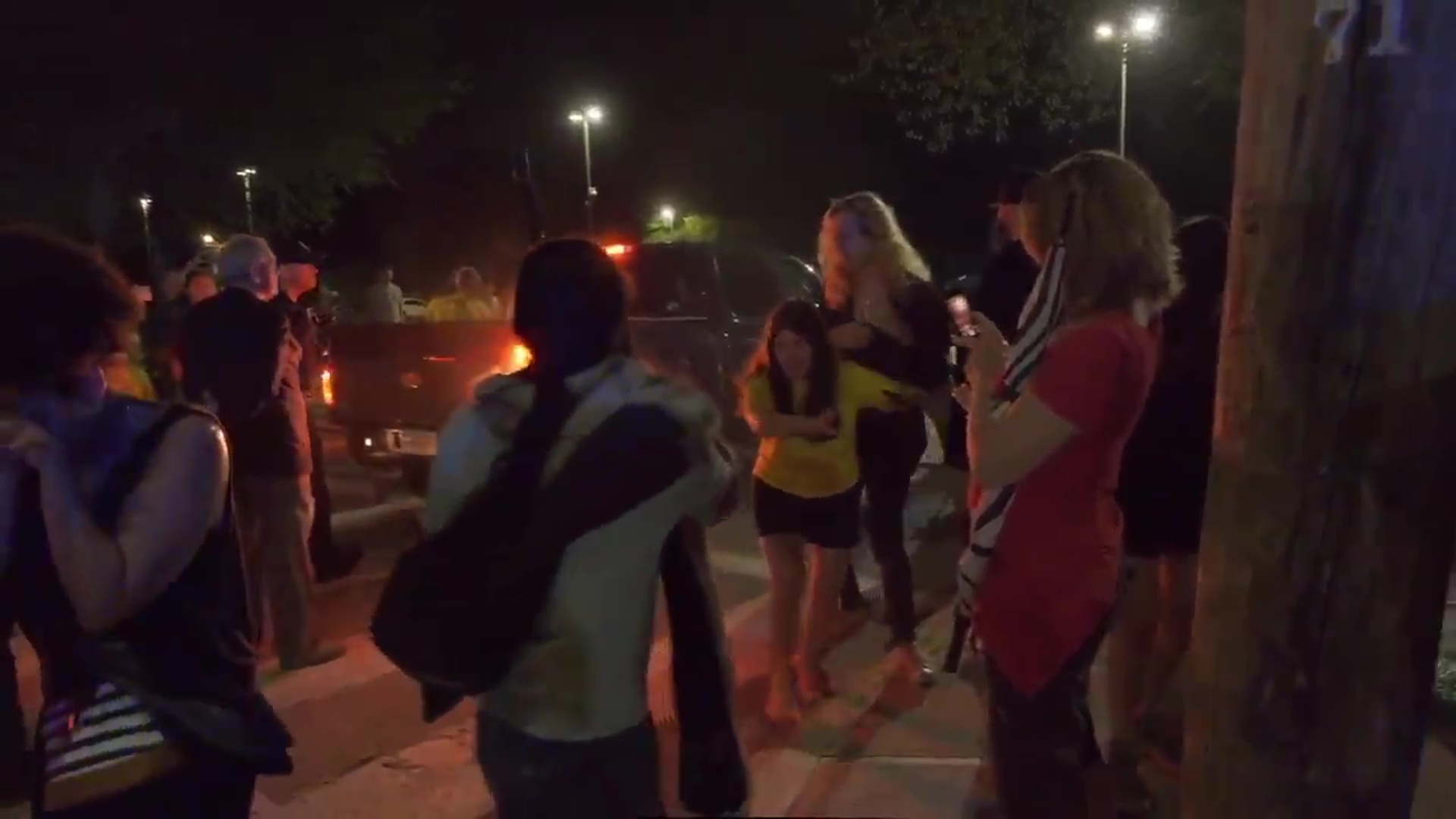 A still from video posted by Never Again Action shows demonstrators sicked by pepper-spray outside the Wyatt Detention Facility in Central Falls, Wednesday, Aug. 15, 2019. (WJAR)