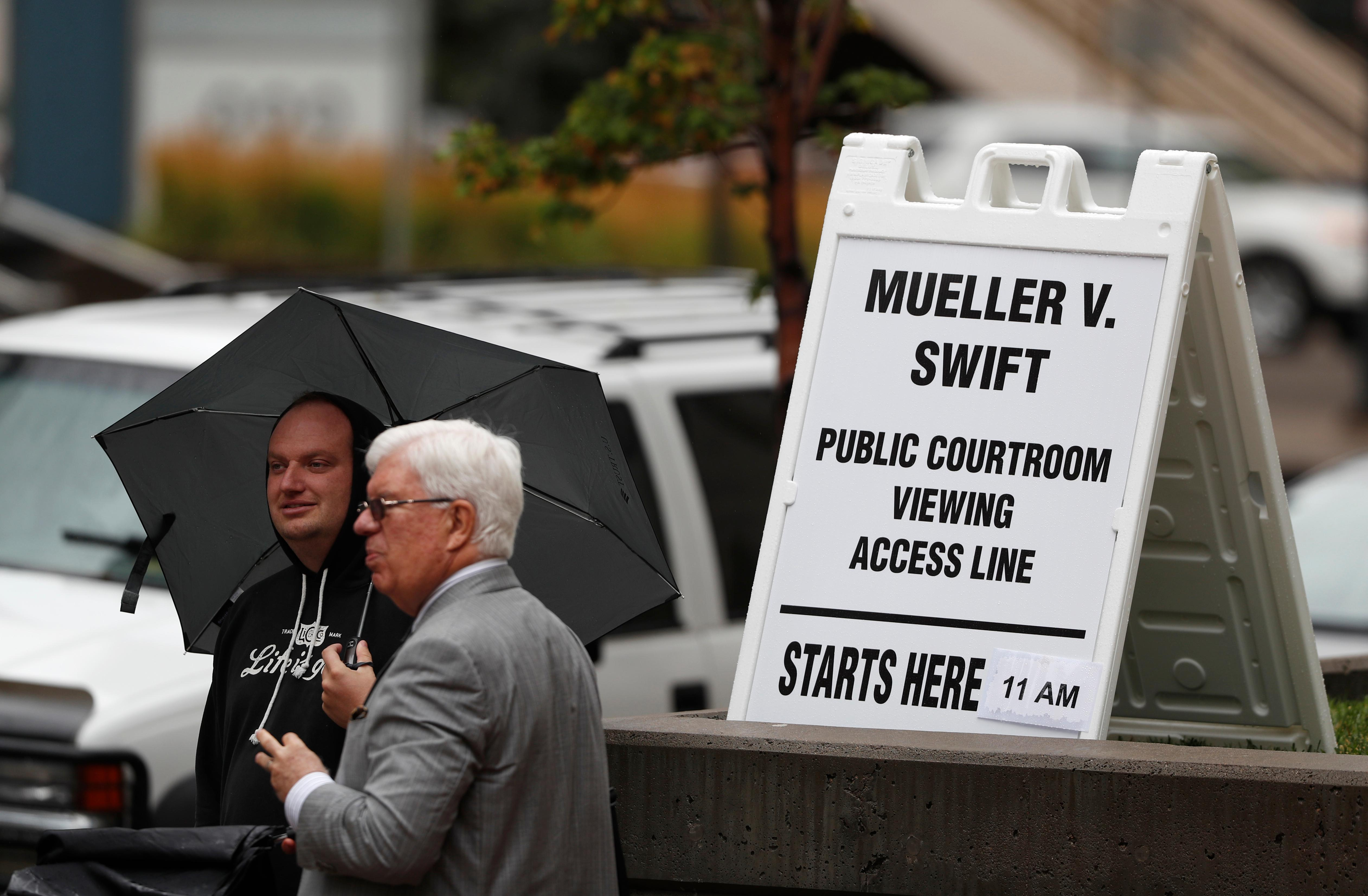 Members of the public Arthur Lewis, left, and Bruce Conant, both of Denver, wait to attend the jury selection phase in a civil trial to determine whether a radio host groped pop singer Taylor Swift as the case opens in federal court Monday, Aug. 7, 2017, in Denver. (AP Photo/David Zalubowski)