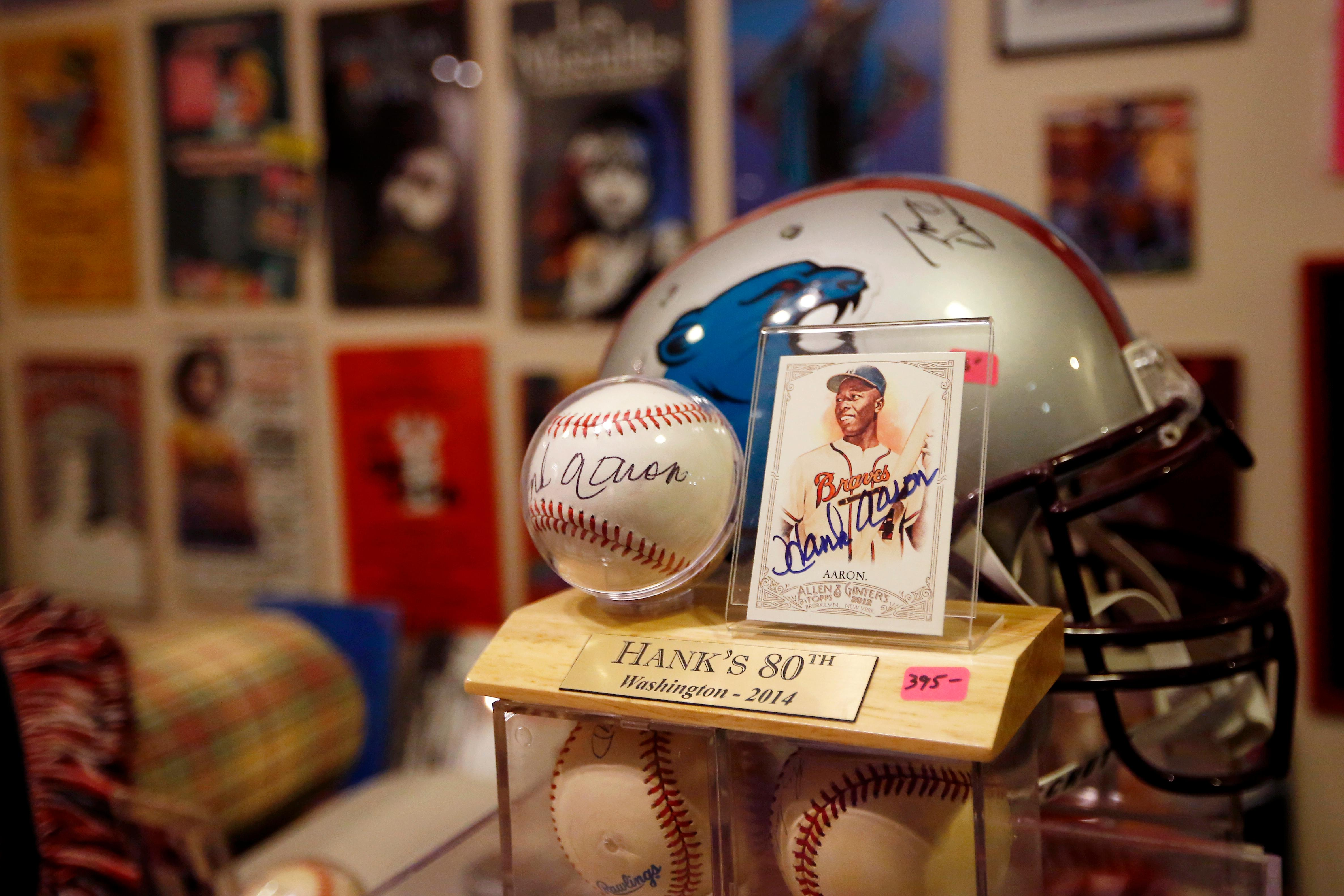Bob Hope's baseball and trading card signed by Hank Aaron, a baseball player in the Hall of Fame, are marked to sell at $395, Friday, Aug. 23, 2019, in Stone Mountain, Ga. (AP Photo/Andrea Smith)