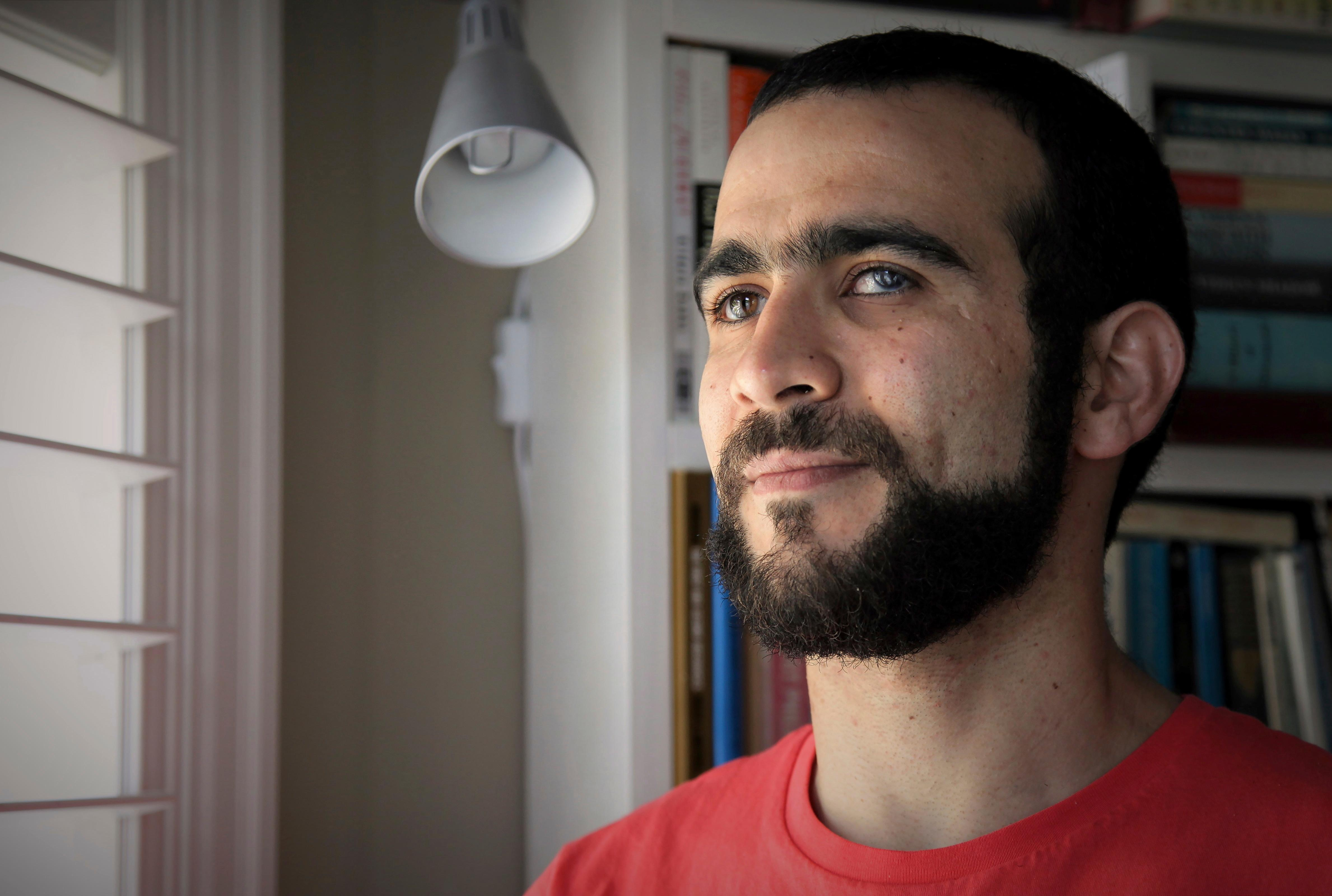 Former Guantanamo Bay prisoner Omar Khadr, 30, is seen at a home in Mississauga, Ont., on Thursday, July 6, 2017. The federal government has paid Khadr $10.5 million and apologized to him for violating his rights during his long ordeal after capture by American forces in Afghanistan in July 2002.  (Colin Perkel/The Canadian Press via AP)
