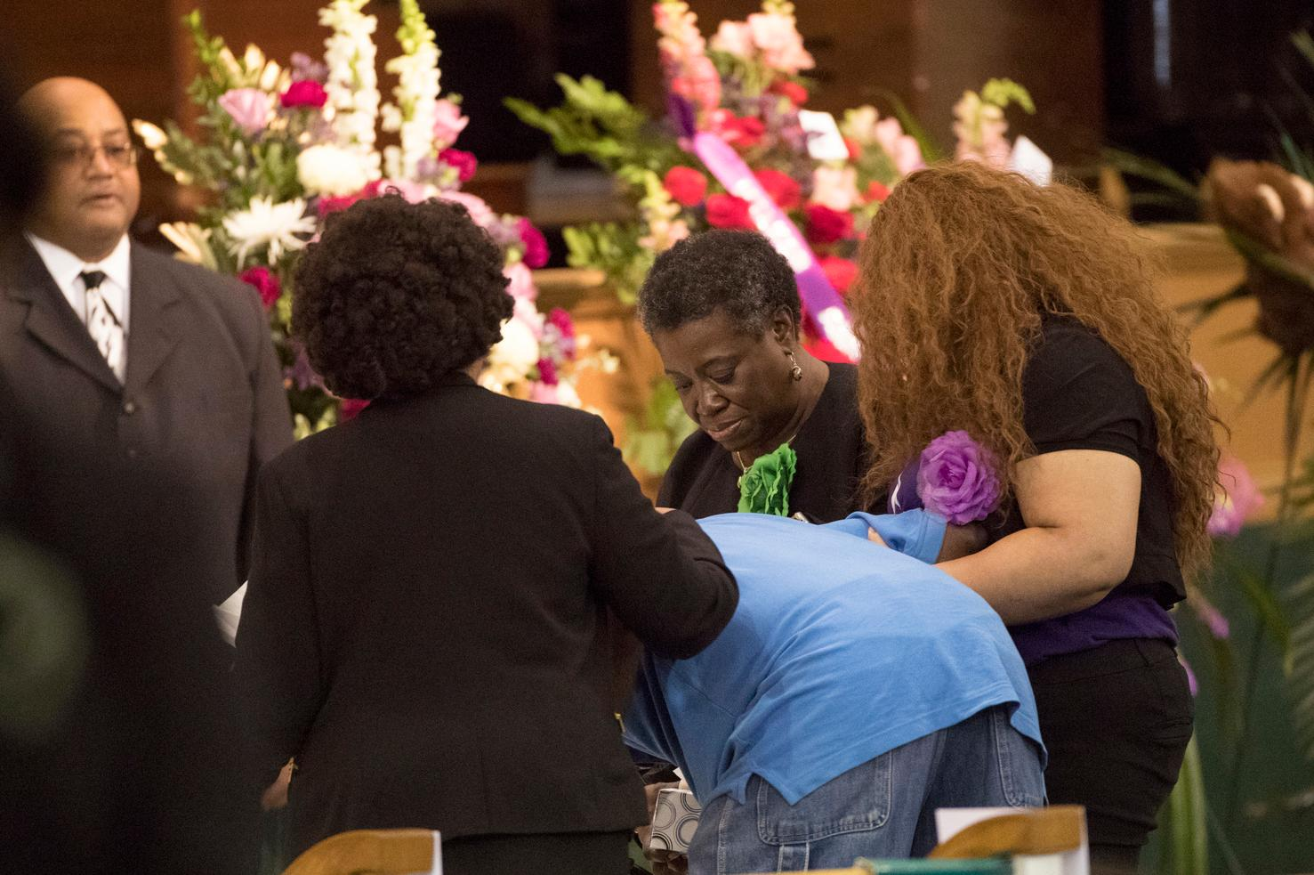 Three women hold a man as he becomes emotional approaching the casket of Jazmine Barnes during a viewing ceremony before the memorial services on Tuesday, Jan. 8, 2019 at the Community of Faith Church in Houston.  Barnes was fatally shot, Dec. 30, 2019,  while in a car with her family during an attack that investigators say appears to be a case of mistaken identity.  (Marie De Jesus/Houston Chronicle via AP)