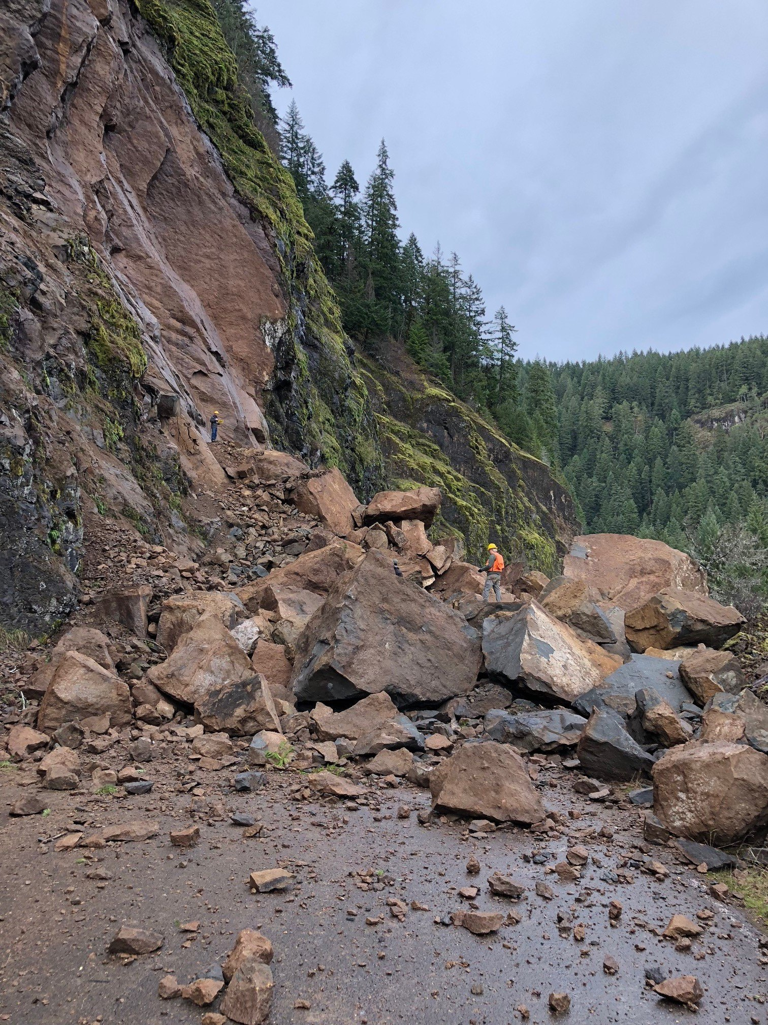 "The landslide has piled rocks 30 feet high across a 250-foot stretch of road, according to the Forest Service. Geologists and engineers visited the slide on December 28. ""Their plan is to have specialists loosen the material still perched above what has fallen onto the road and then, as soon as possible, remove the approximately 8,000 cubic yards of rock that are on the road bed,"" according to the Forest Service. (USDA Forest Service)"