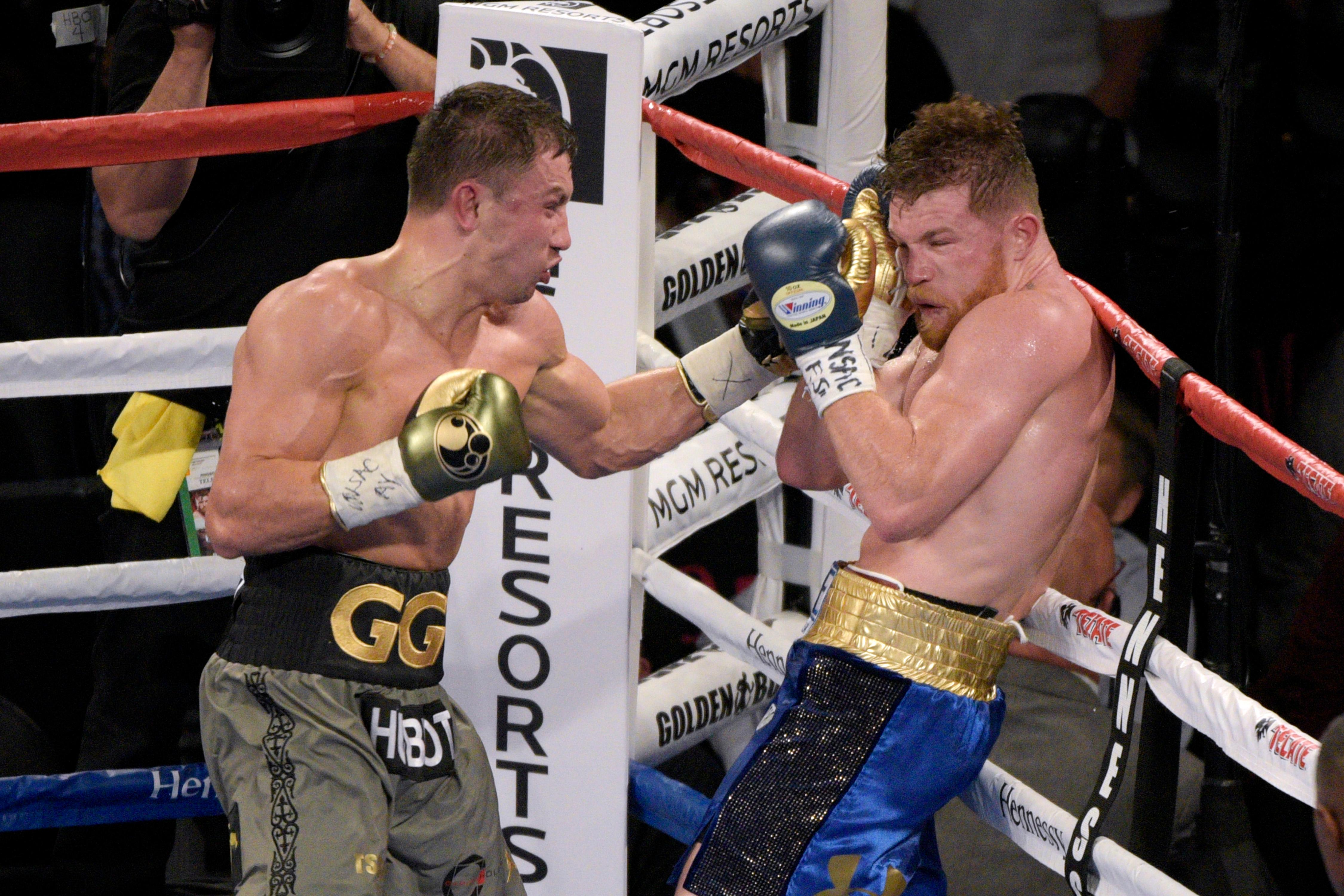 Unanimous middleweight champion Gennady Golovkin hits Canelo Alvarez with a left during their fight Saturday, September 16, 2017, at the T-Mobile Arena in Las Vegas. The fight was declared a draw. [Sam Morris/Las Vegas News Bureau]