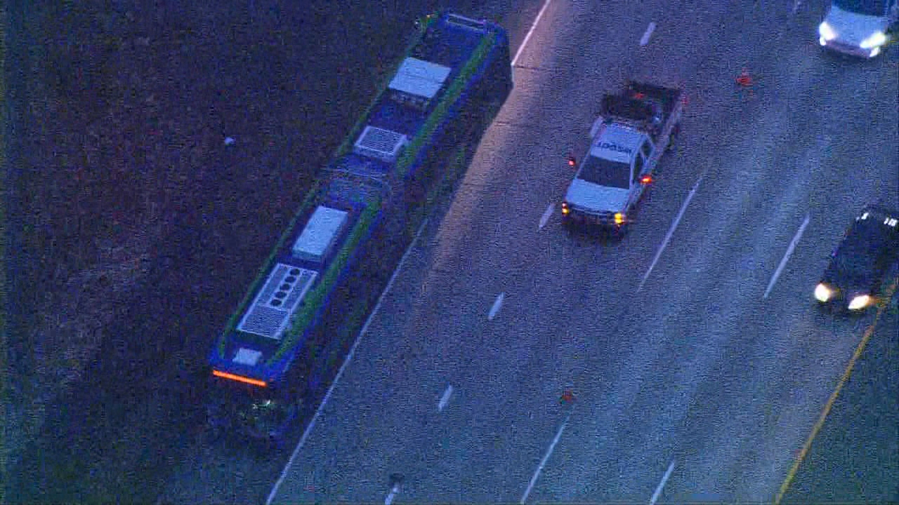 At least 1 dead as car collides with bus on I-90 (KOMO Photo)