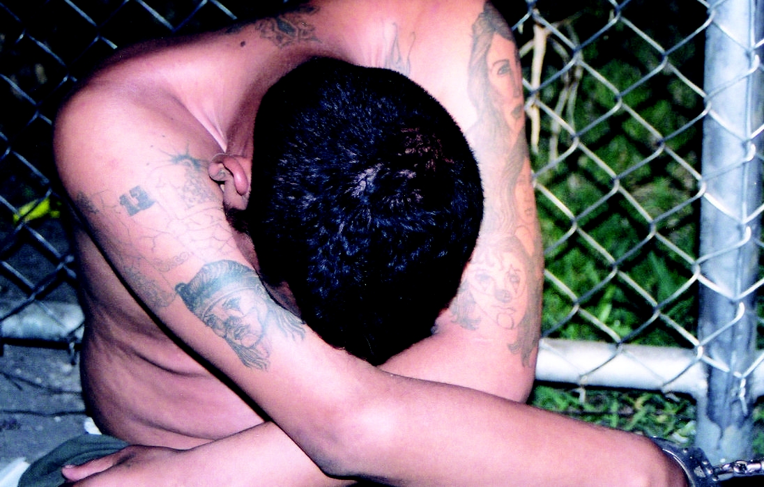 FILE - This undated FBI photo shows a shirtless members of the MS-13 street gang. (FBI.gov)