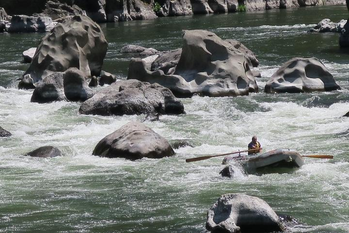 Walls of huge rocks challenge boaters traveling through Blossom Bar, the Rogue's most challenging rapids. Photo by Lee Juillerat