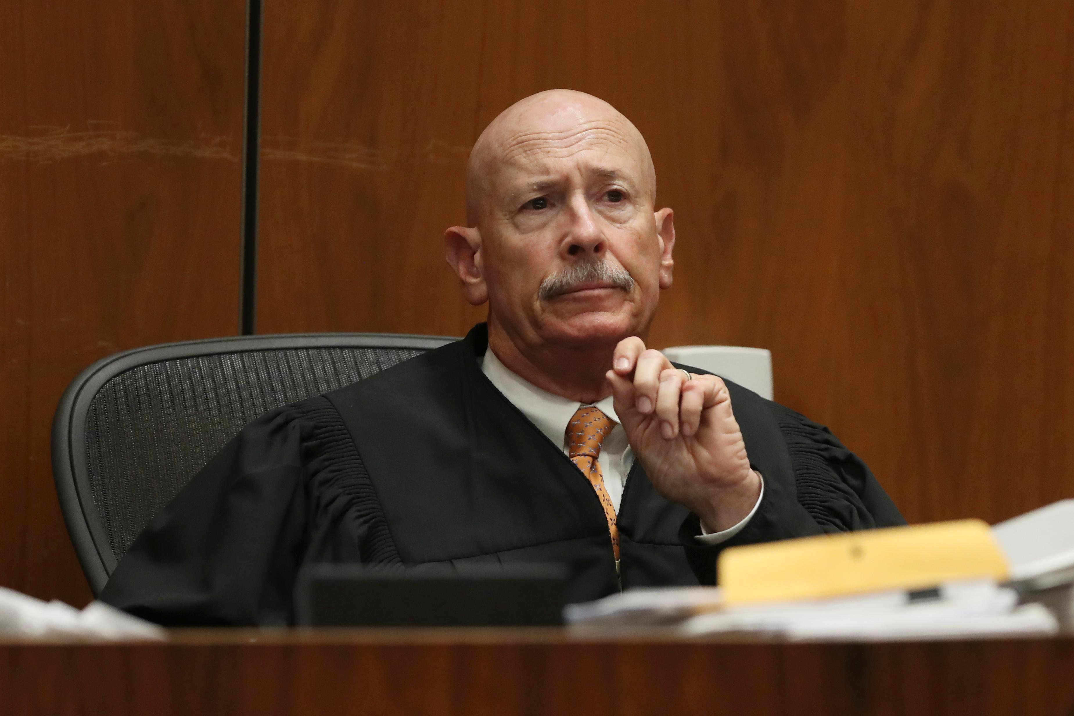 Judge Larry P. Fidler listens to closing arguments in the trial of People vs. Michael Gargiulo Tuesday, Aug. 6, 2019, in Los Angeles. (Lucy Nicholson, Pool Photo via AP)