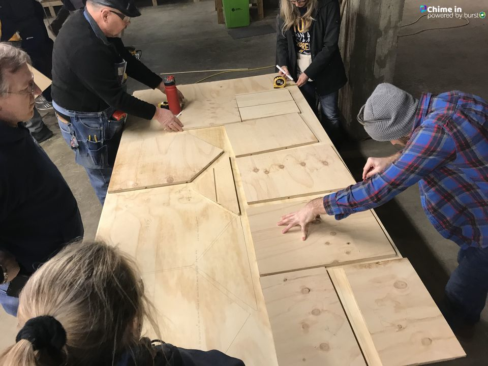 Genesee County Habitat for Humanity hosted their annual Martin Luther King Day project. They are partnering with University of Michigan Flint to build ten 'little free libraries' Monday. (Photo: WEYI/WSMH)