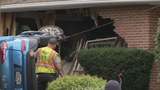 Springfield homeowner could have been changing oil in his garage when car slammed in to it