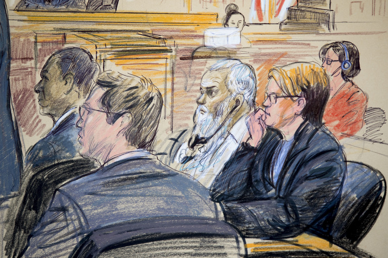 This courtroom sketch shows Ahmed Abu Khattala, third from right, listening to an interpreter through earphones during the opening statement by his defense attorney Jeffery Robinson in federal court in Washington Monday, Oct. 2, 2017. Khattala, the suspected mastermind of the 2012 attacks on a diplomatic compound in Benghazi, Libya, that killed four Americans, is on trial. Also depicted are members of the defense team Cole Lutermilch, left, and Michelle Peterson, second from right. (Dana Verkouteren via AP)