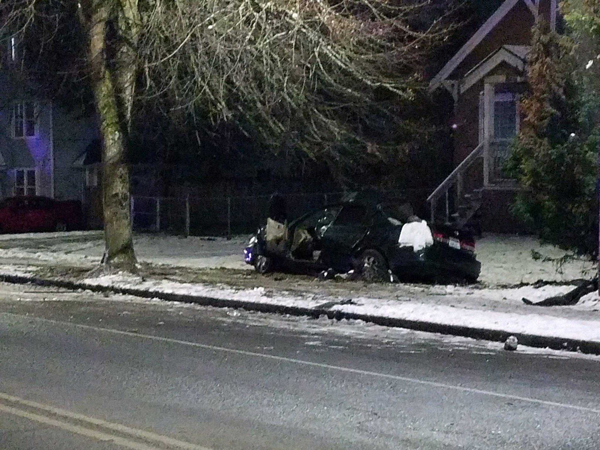 Wreckage left after car crashes into tree in Burien. (Photo: King County Sheriff's Office)
