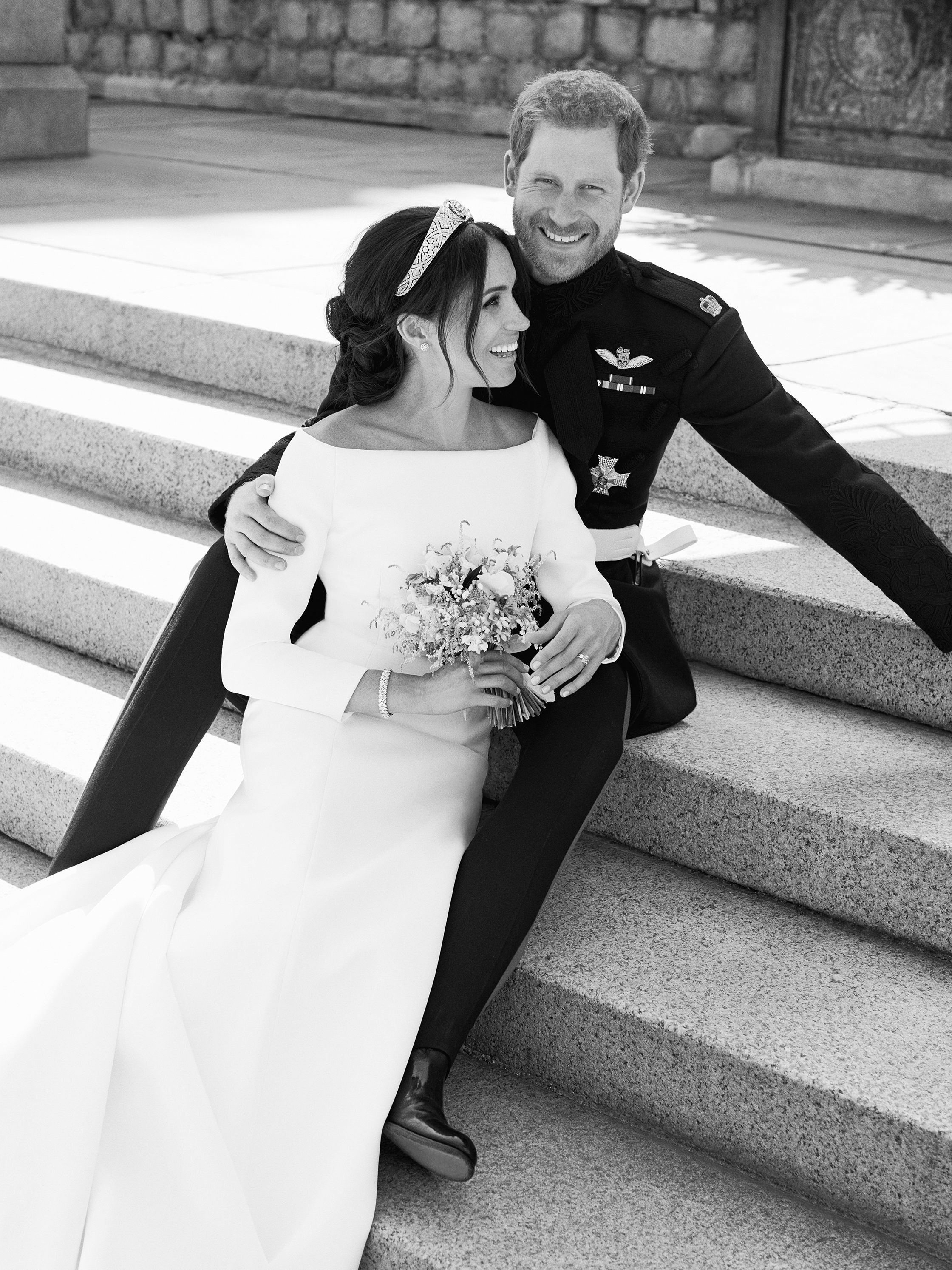 This photo released by Kensington Palace on Monday May 21, 2018, shows an official wedding photo of Britain's Prince Harry and Meghan Markle, on the East Terrace of Windsor Castle, Windsor, England, Saturday May 19, 2018. (Alexi Lubomirski/Kensington Palace via AP)