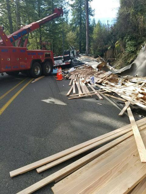 A lumber truck crash closed OR 226 Albany-Lyons Highway on Tuesday while crews worked to clear the truck from the road and repair a downed power line. (ODOT)