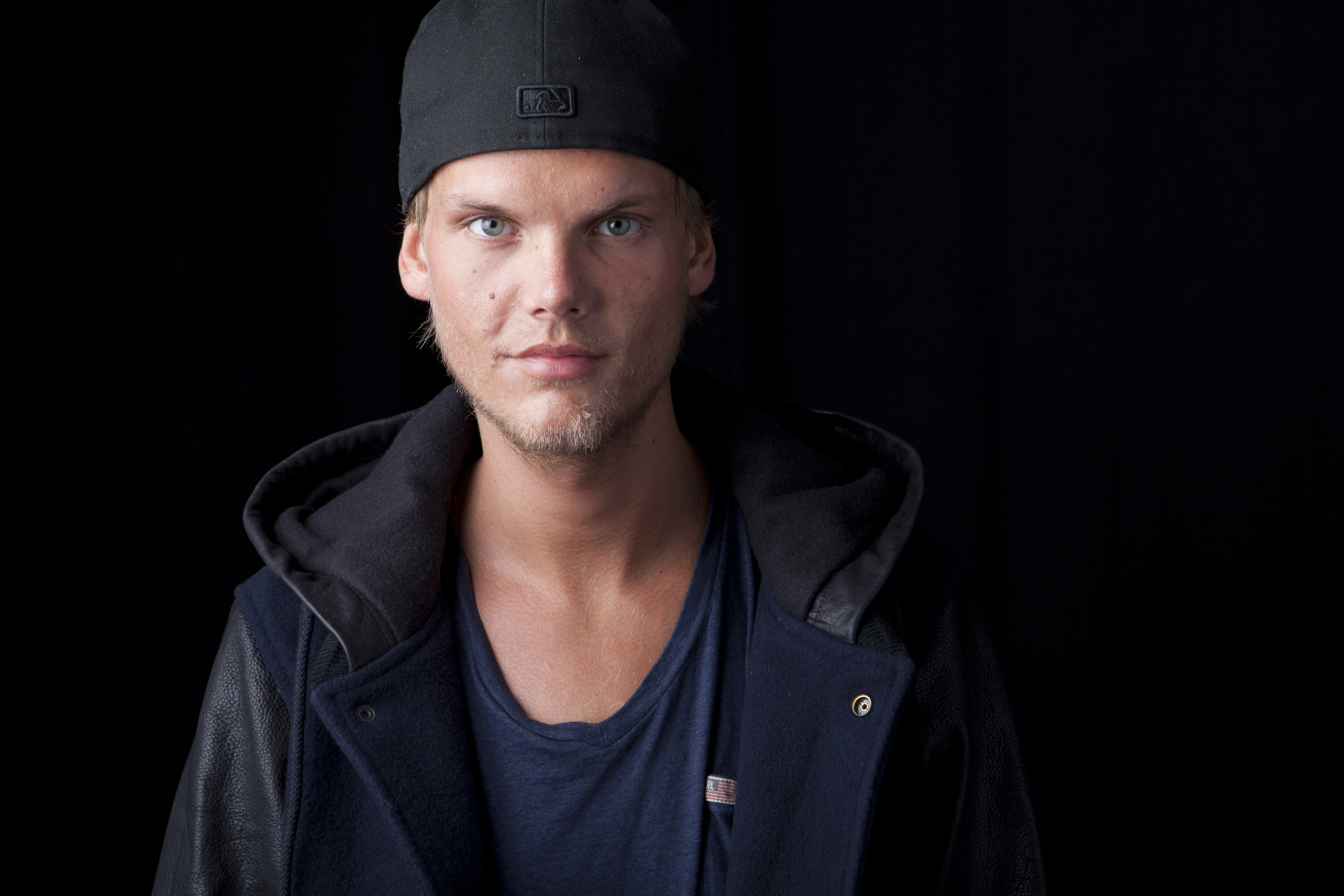 FILE - In this Aug. 30, 2013 file photo, Swedish DJ, remixer and record producer Avicii poses for a portrait, in New York. (Photo by Amy Sussman/Invision/AP, File)