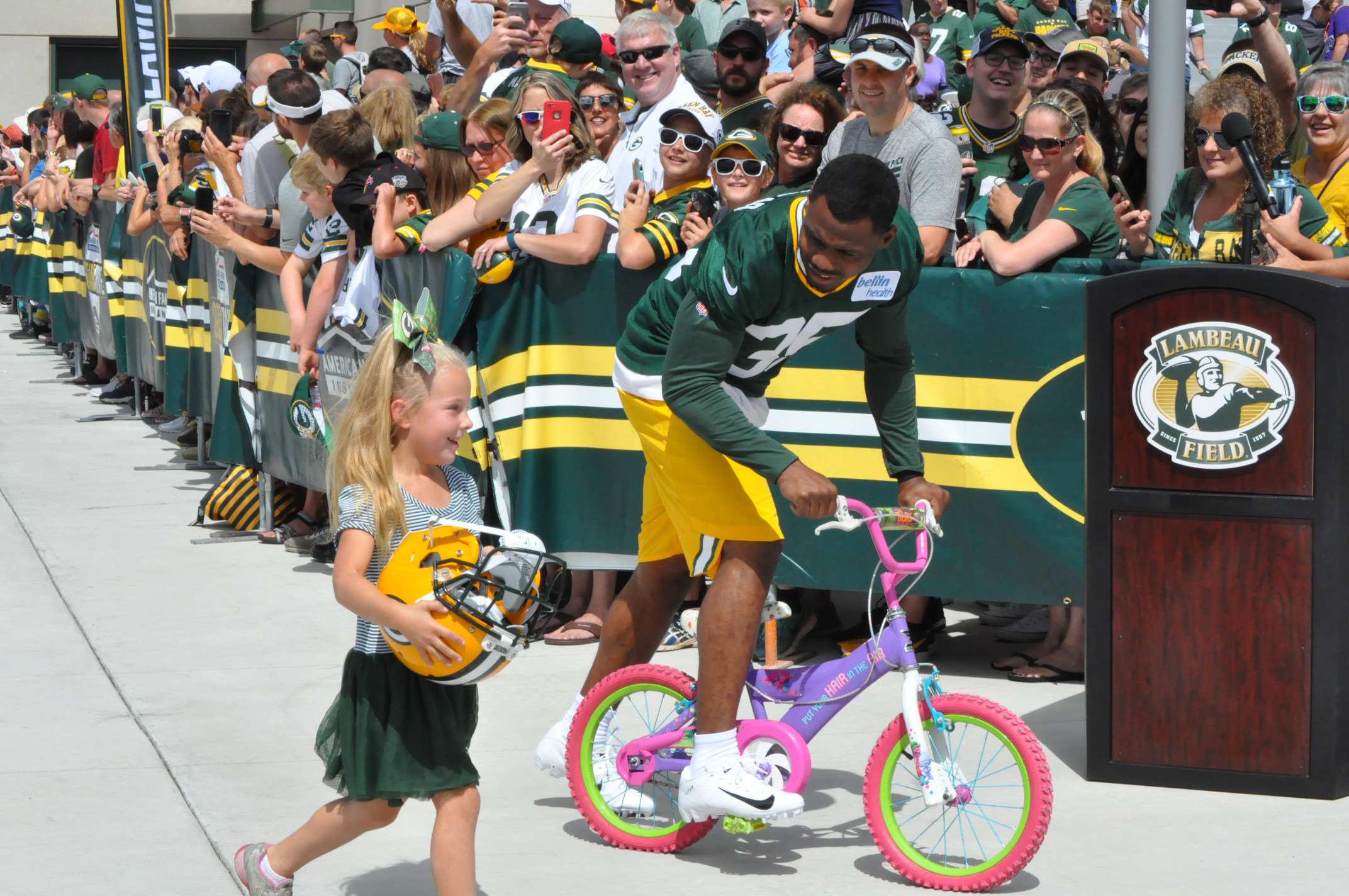 Green Bay Packers' Jermaine Whitehead (35) rides a child's bicycle to training camp practice July 26, 2018. (WLUK/Sierra Trojan)
