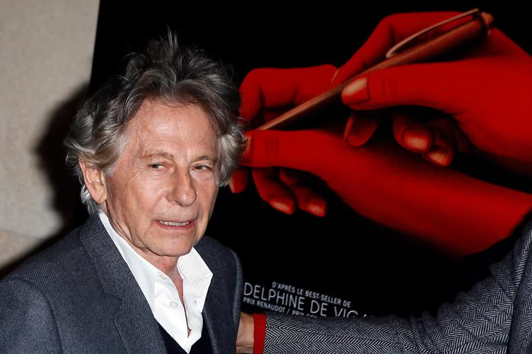 "FILE - In this Oct. 30, 3017 file photo director Roman Polanski poses during a photo call prior to the screening of ""Based on a true story"" in Paris, France. Swiss prosecutors say they won't pursue an investigation of Oscar-winning director Roman Polanski over allegations by a German woman that he raped her when she was a teenager 45 years ago. Prosecutors in the Swiss capital, Bern, said Wednesday Nov. 8, 2017 that the alleged crime of sexual actions with children has long since fallen under the statute of limitations, which was 15 years at the time. (AP Photo/Francois Mori,file)"