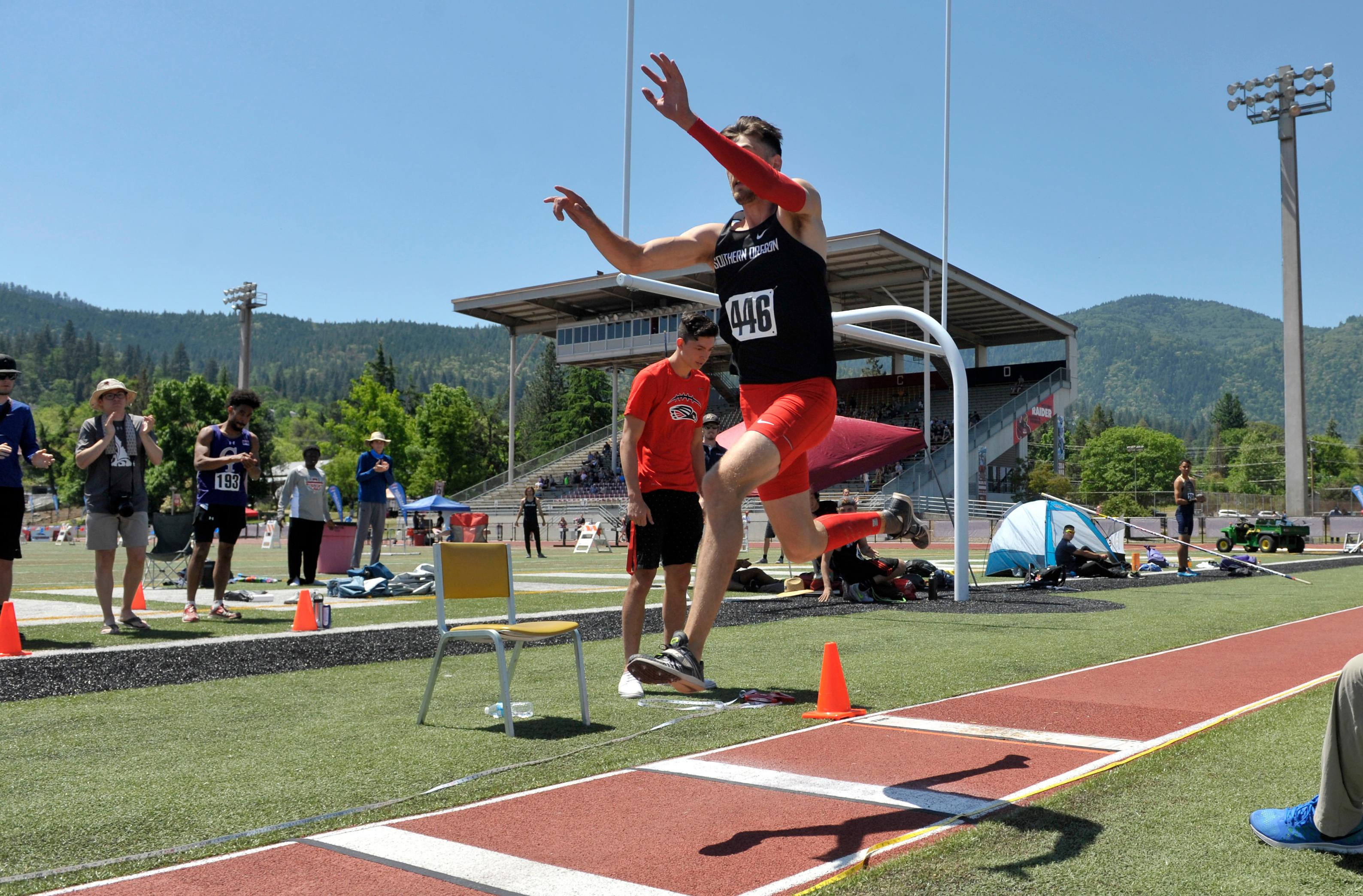 Andy Atkinson / Mail TribuneZach Beltz launches from the board with his last attempt in the finals winning the triple jump with a meet record.