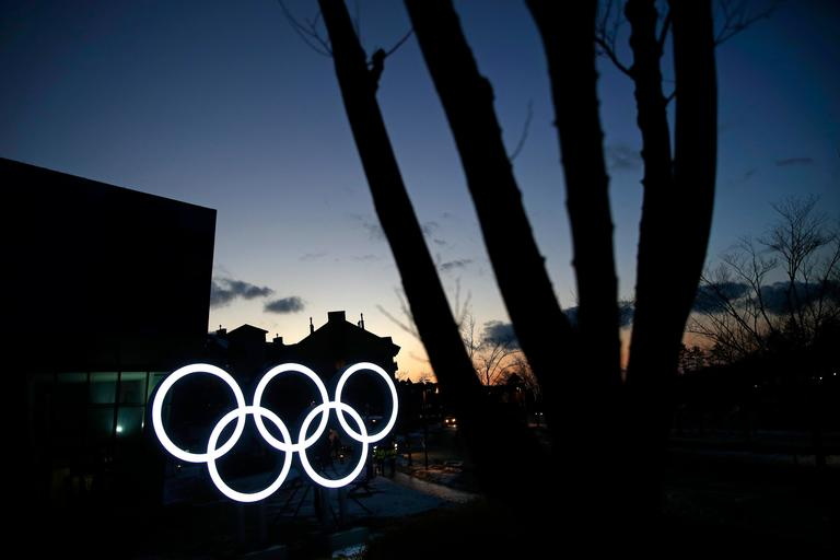 Illuminated Olympic rings shine at dusk at the Alpensia resort prior to the 2018 Winter Olympics in Pyeongchang, South Korea, Friday, Feb. 2, 2018. (AP Photo/Patrick Semansky)