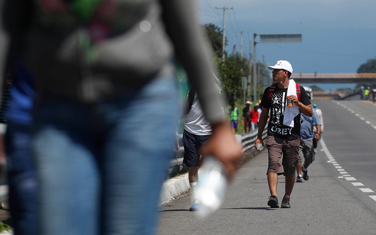 Central American migrants making their way to the U.S. arrive by foot to Tapachula, Mexico, Sunday, Oct. 21, 2018. Despite Mexican efforts to stop them at the Guatemala-Mexico border, about 5,000 Central American migrants resumed their advance toward the U.S. border Sunday in southern Mexico. (AP Photo/Moises Castillo)