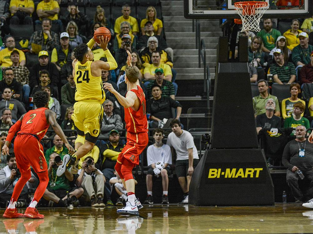 Ducks Dillon Brooks (#24) leaves his feet in order to get the shot off. In front of a sellout crowd the Ducks beat No. 5 Arizona 85-58, shooting a Mathew Knight Arena record 16 three-pointers, to clinch their 40th victory in a row at home. Photo by Jacob Smith, Oregon News Lab