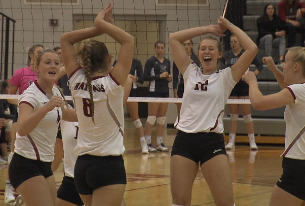Hastings College sophomore Elise Baumann (8) and the Broncos celebrate after Baumann served an ace versus Concordia. (KHGI)