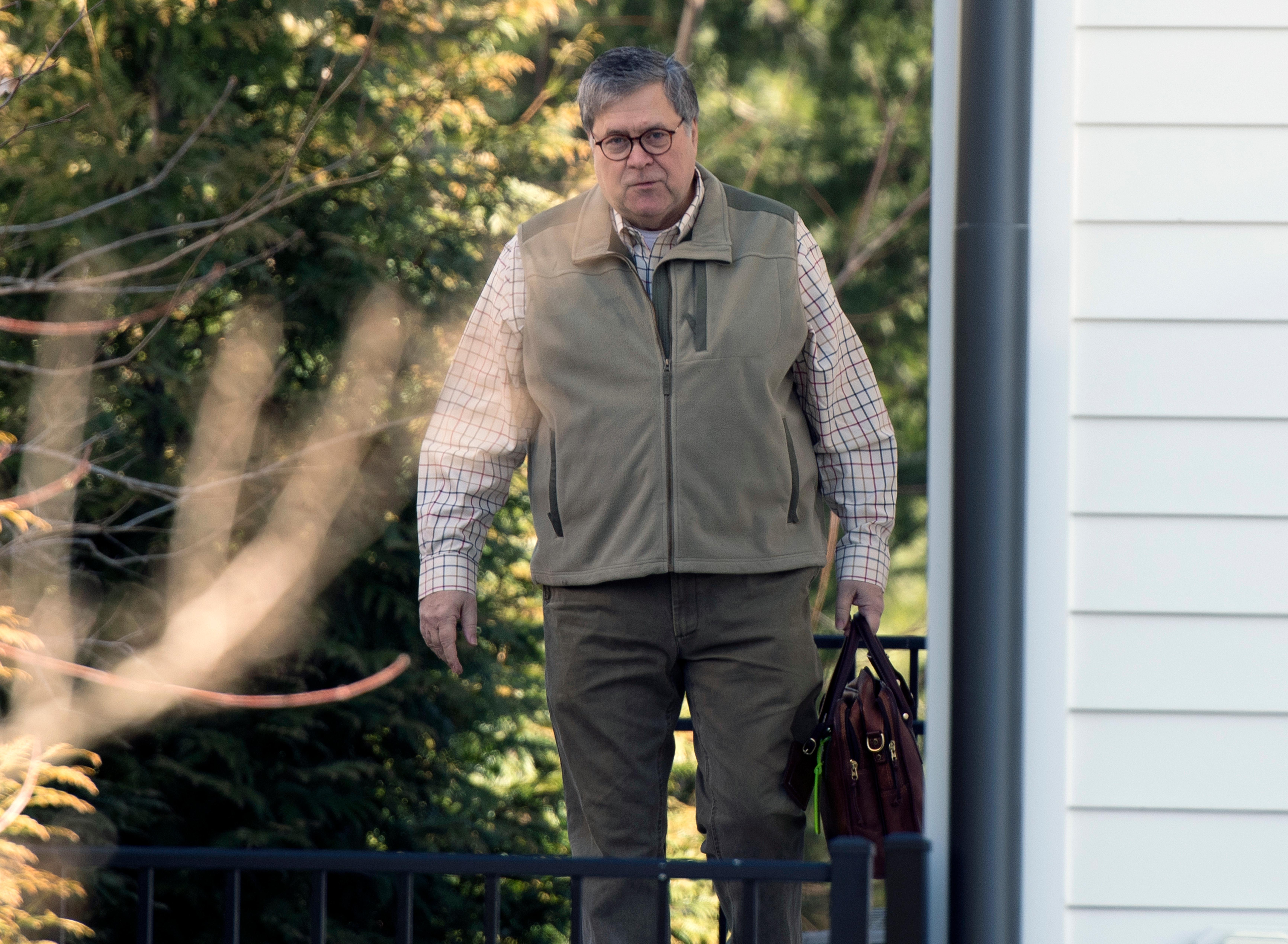 Attorney General William Barr leaves his home in McLean, Va., on Sunday morning, March 24, 2019. Barr is preparing a summary of the findings of the special counsel investigating Russian election interference.  The release of Barr's summary of the report's main conclusions is expected sometime Sunday. (AP Photo/Sait Serkan Gurbuz)