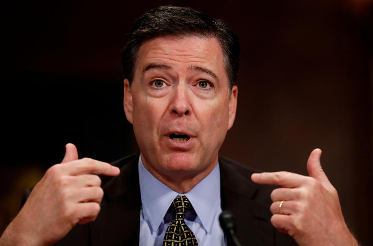 "FILE - In this May 3, 2017, file photo, then-FBI Director James Comey testifies on Capitol Hill in Washington. Comey is blasting President Donald Trump as unethical and ""untethered to truth"" and his leadership of the country as ""ego driven and about personal loyalty."" Comey's comments come in a new book in which he casts Trump as a mafia boss-like figure who sought to blur the line between law enforcement and politics and tried to pressure him regarding the investigation into Russian election interference. (AP Photo/Carolyn Kaster)"