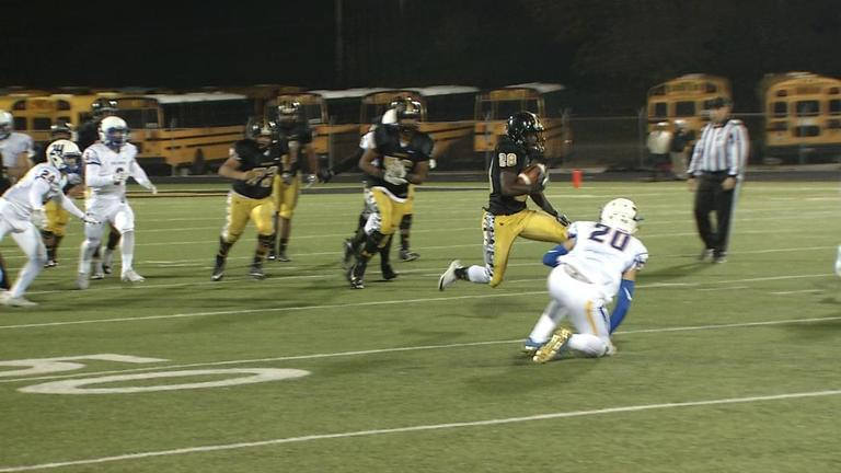 Midwest City's Astin Anderson dodges the Stillwater backfield  (David Young / KOKH)